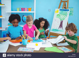 happy kids doing arts and crafts together stock photo royalty