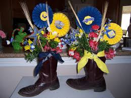 banquet centerpieces blue and gold banquet centerpieces using his boots as the base