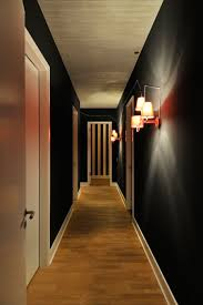 Hallway Lighting Ideas by Inviting Penthouse With Solid Black Walls And Modern Hallway