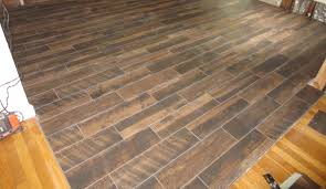 wood look plank tile installation lapse on schluter ditra