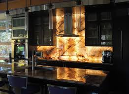 9 eye catching backsplash ideas for every kitchen style illuminated brazilian quartzite backsplash photo source concept tile com
