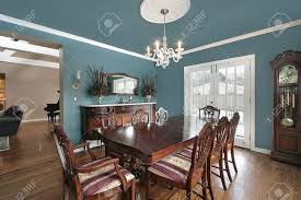 elegant dining room with slate blue walls stock photo picture and