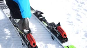 how to clip ski boots into bindings youtube