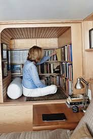 the tiny new york apartment with an unusual library ideas for
