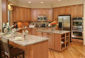 kitchen island light brown paneled kitchenp cabinets light brown