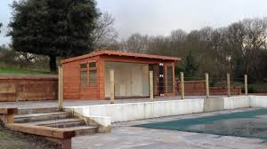 garden pool room with integrated changing room and storage by