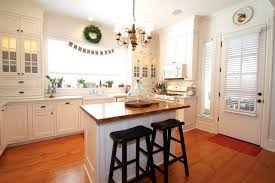 pictures of small kitchen islands white small kitchen island with glossy wooden top and black