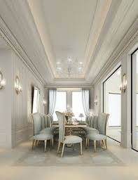 Interior Design Dining Room A Predominantly White Room With Blue Accent Chairs A Striking