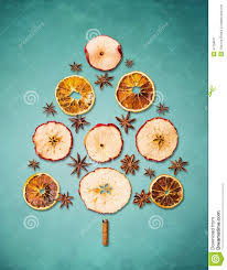 dry winter fruits christmas tree on blue background stock photo