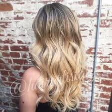 bright beige blonde highlights long layered haircut hair by aly