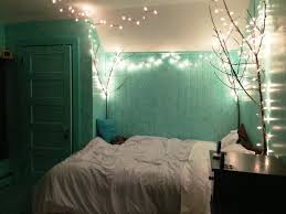 decor nightstand and bedding with accent walls also string light