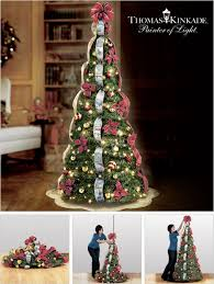 kinkade pre lit pull up tree makes decorating