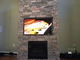 flat screen installation on a brick wall or fireplace neuwave