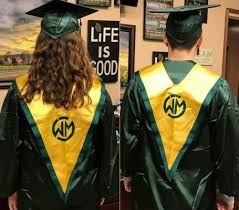 green cap and gown students protest gender neutral graduation gowns tradition has