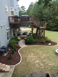 Backyard Deck And Patio Ideas by Curves Like Lombard Street Alabama Decking And Deck Landscaping