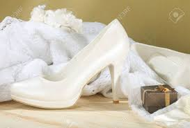 wedding shoes next white bridal wedding shoes next to decorative lace stock photo