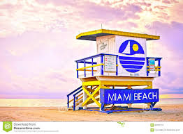 sunrise in miami beach florida with a colorful lifeguard house