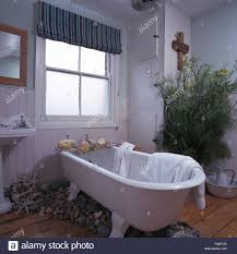 striped blind on frosted window in nineties bathroom with large