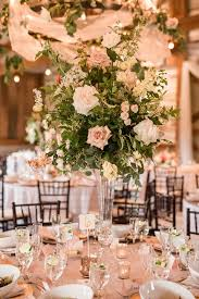 wedding floral centerpieces playful and southern blush wedding with floral print hey