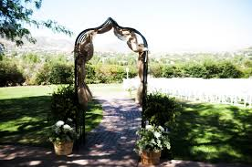 wedding arches decorated with burlap dreamy ceremony decor manor house