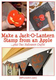 two halloween jack o lantern stamp crafts made using an apple