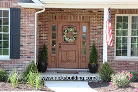 the great american entrance red brick house with tan door door