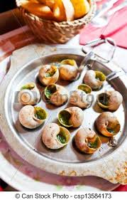 escargot cuisine escargots plate of escargot shells with special tongs