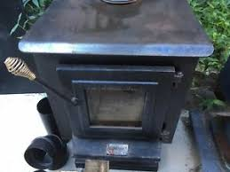 pair of wood burning stoves one made by elmira stove works and