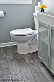 remodelaholic modern bathroom update bathroom tiled floor and