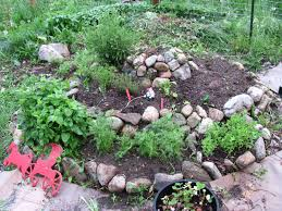 permaculture how to build a herb spiral family food garden