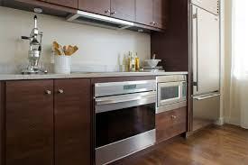 modern kitchen appliances with dark brown kitchen furniture