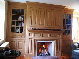 hand crafted farmhouse mantel wall with tv enclosure by campbell