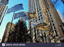new york city rockefeller center with gold and silver flying