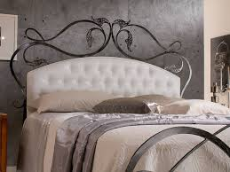 bedroom white tufted headboard with dresser and white bedding for