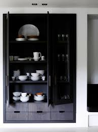white wall and black inset cabinetry interior design home