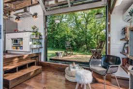photos of interiors of homes inside a tiny house with a pop out deck alpha tiny home by new