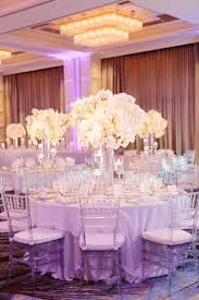 the couple decorated their reception with frosted and clear glass the couple decorated their reception with frosted and clear glass stemware glass chargers white