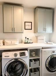 best place to buy cabinets for laundry room adding inexpensive painted cabinets in our laundry room 11