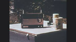 1970s radio sits next to paint can cars drive past tornado man