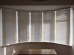 wood venetian blinds in chalk colour fitted to a 5 sectioned bay