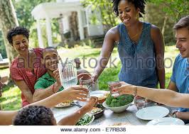 a family gathering in the garden in summer stock photo royalty