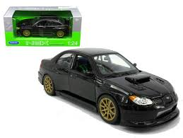 black subaru impreza wrx sti black 1 24 scale diecast car model by welly 22487