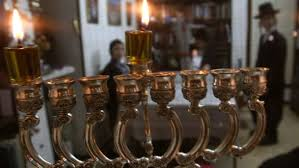 hanukkah candles why do jews light hanukkah candles anyway world haaretz