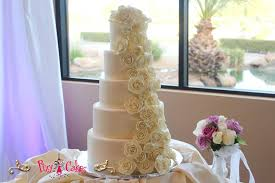 wedding cake gum wedding cake closeup 4 tier beige white gumpaste flowers cascading