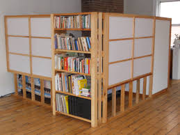 smart natural wooden room divider with white shades and book case