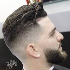 fades and shave hairstyle for women medium even transition skin fade with loose pompadour shaved