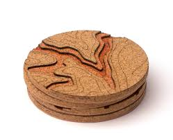 these cork topo coasters are carved with the geography of real