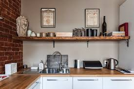 studio apartment kitchen ideas studio apartment stays authentic by keeping its brick walls intact