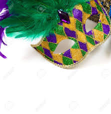 green mardi gras mask a glittery mardi gras mask on a white background with copyspace