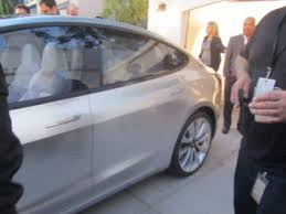 tesla model 3 makes a rare cameo at the solar roof event video